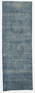 Very faded indigo-dyed hemp (?) with a starch-resist pattern in white. Two lobed medallions enclosing figures riding dragons, surrounded by deer, birds, and abstract pattern. Border at each end with butterflies, flowers, and crossed flags.