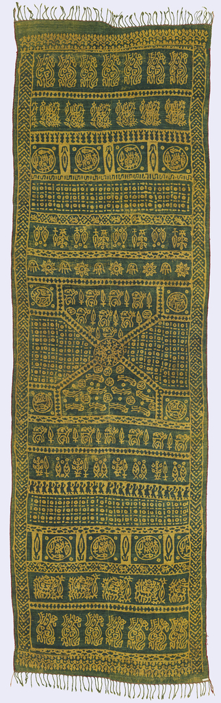 Long panel of printed silk. Design reserved in yellow against a dark blue-green ground. Probably resist-printed in indigo over yellow. Center, a square arrangement with triangular sections framing stylized animal and geometric forms. Nine horizontal bands of varying widths cover both ends, showing highly stylized animal and geometric forms, trees, and human figures. Edges bound in cord; fringe on two ends.