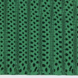 Length of patterned knit with technical and molecular references is a structured knit and engineered a net of ovals which interlock to form large vertical stripes. Evenly stacked lengthwise in size order, the staggered arrangement of three scales of ovals has a sense of ascension.