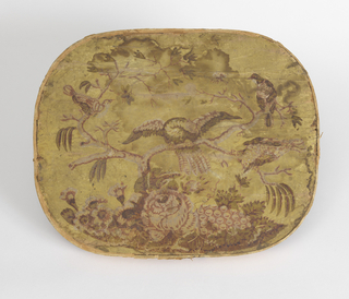 "Wooden bandbox lid covered with wallpaper. Yellow background, on base of flowers and grapes, branch with four birds perched on it, in green and pinks. Brood of fledgling eagles -""Eagles on Aerie"". Rim: covered with plain paper."