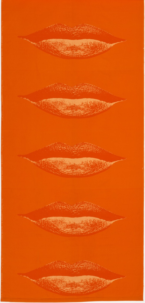 Length of orange cotton printed with large, photo-realist lips, in slightly paler orange.