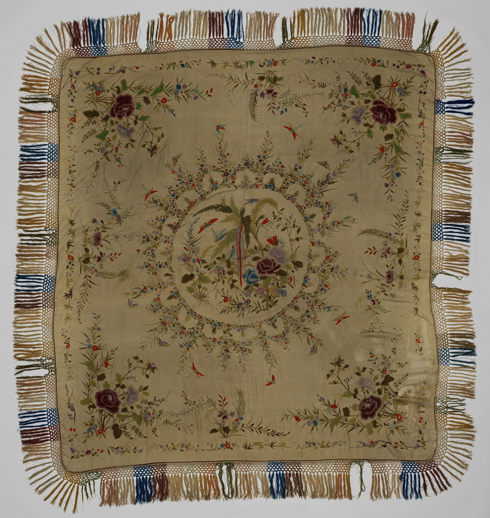 Flowers and insects arranged in central and border ornaments. Shawl lined with silk and used as table cover.