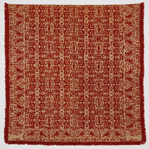 """Coverlet with a design of highly stylized plants forms and stars in red wool on a cream ground. Wide border with birds on either side of a tree. In two corners, marks that read: """"Made by T. Fehr in Lower Saucon for . 1842."""""""