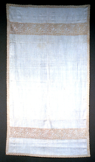 White towel with embroidered bands that depict Cupid shooting an arrow at a reclining nude. After a pattern by Mateo Pagano.