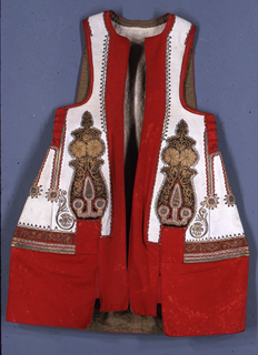 Sleeveless jacket of off-white wool broadcloth, embroidered with a deep border around bottom and armholes. Applique of red velvet, with gold braid and embroidery.