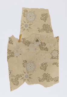 Stylized floral or sunburst design, with small areas of curly lines. Printed in white and brown on tan ground.