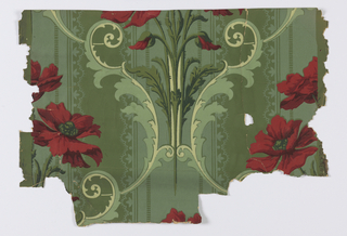 Large-scale red poppies set within scrolling medallion. Printed on green striped ground.