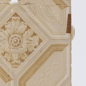 Trompe l'oeil design with acanthus rosette set within elaborate architectural coffered framework. The moldings contain beading, with tracery set within the framework. Printed in shades of tan and white.