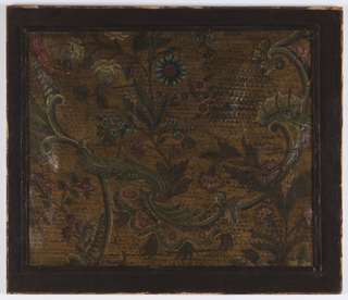 Stamped field with scrollwork and foliage. Painted in green, blue, and red on blue field.