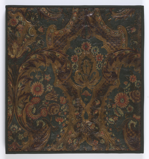 Embossed with scrollwork and foliage, 2 game birds on a green field.