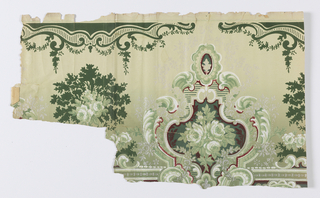 Green and white roses in elaborate floral cartouche. Printed on graduated green ground.