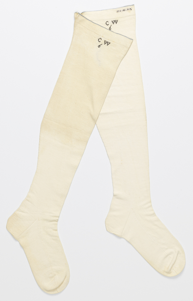 Pair of white stockings with a blue line at the top. Black cross stitch at top as well.