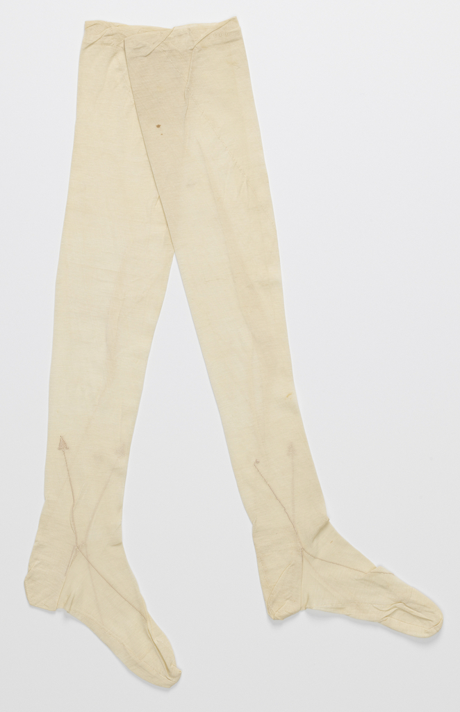 White stocking with simple clocks embroidered in white silk.