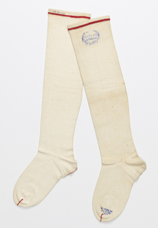 "Pair of white stockings with red lines at the top, toes and heels. On one at the top, a blue stamp of an open wreath with ""Patent Four Thread"" in the center. On same stocking at the toe, ""British 9 in."""