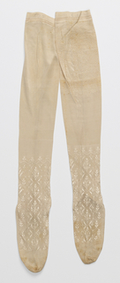 Pair of white stockings with an elaborate design of floral motifs and vertical diamonds over the instep and ankle. Two narrow bands of brown silk at the top. Initials CAP on each in ink.