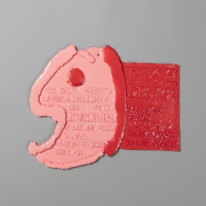 Poured pink and red polyurethane resin form reminscent of a fish, with details of invitation to a Pesce show pressed into the surface, pink and red.