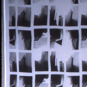 a; a repetition of 6 photo images of skyscrapers along Park Avenue. in silver on black. b. same pattern in black on white.