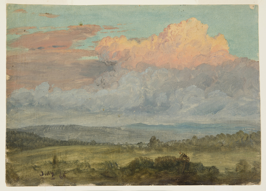 Underneath a high sky of reddened dawn clouds, a grassy landscape opens to gentle hills.