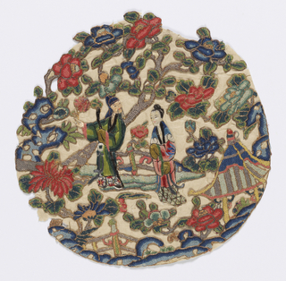 Roundel with an elderly man and young lady in a garden surrounded by flowering trees. In polychrome silks outlined in gold thread embroidery.