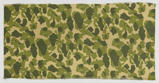 Length of beige camouflage cloth woven in a square allover pattern is printed in two shades of olive green. Two selvages continuous with field.