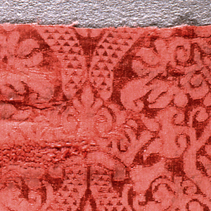 Red damask with a design of symmetrical ogive with crown, etc.