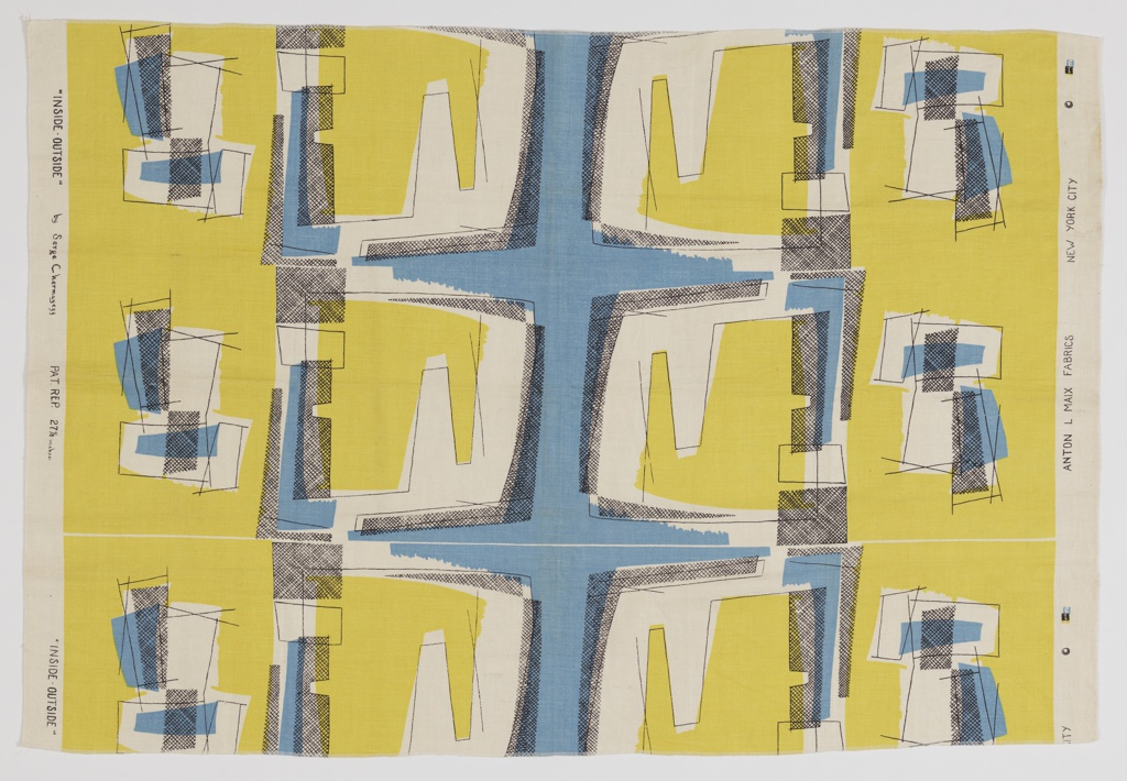 Length of printed textile with abstract geometric design in blues and yellow with black diagonal cross-hatching on a white ground.