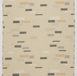 Length of woven textile with an off-white ground and irregular squares and rectangles in different twill weaves and different fibers, in ivory, copper, gray, and dark brown.