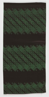 Length of fabric printed on the diagonal for the purpose of making men's ties. Each tie contains two groupings of floral ovals flanked by squares of overlapping scallops. In green and black.