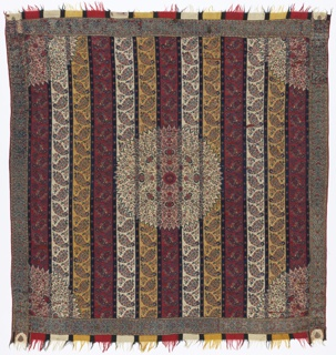 "Square ""moon shawl"" with guard borders on four sides and fringed borders at warp ends only. Broad vertical stripes of red, yellow and white with floral cones, separated by narrow stripes of dark blue. Circular central medallion, with a quarter-circle medallions in each corner with stylized floral filling in blues and red on pink and white ground. Coarse woven border with stylized floral motifs on four sides. Separate borders top and bottom imitate fringed warp ends."