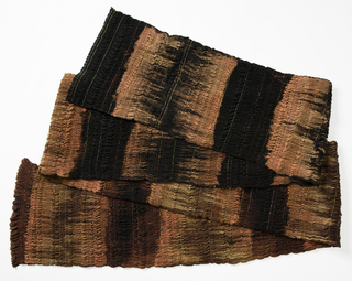 Black and brown fabric, shirred with brightly colored threads.