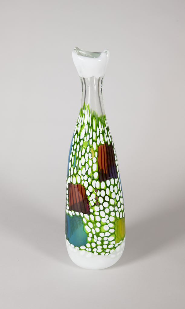 Vessel in cristallo decorated with lattimo and green murrine with square inclusions composed of polychrome glass rods; base and mouth trimmed with lattimo glass stripes