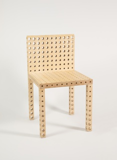 Rectilinear form; the back, seat, and legs perforated front-to-back and left-to-right with circular holes of graduated sizes, the smallest at joints and other stress points. Number 13 in an edition of 50.