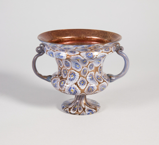 Of campana-urn form the interior of aventurine the exterior with blue and white florette murrines and curved handles