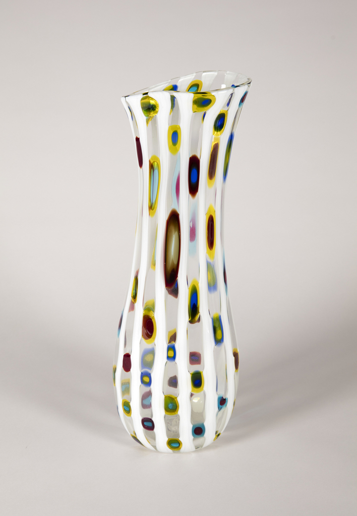 Vase in cristallo decorated with vertical rods of lattimo glass and round murrine in transparent polychrome glass