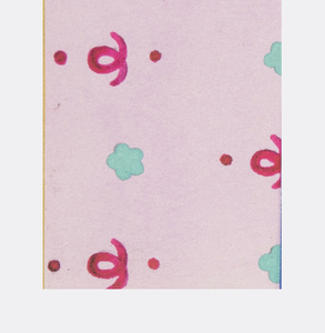 Small patterns of alternating fleurettes and curly cues and dots in rose and turquoise on pink background.