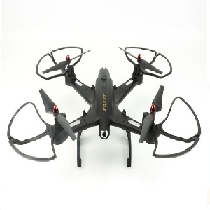 Flying device in black molded plastic with four propellors, four legs, and camera; frame is of foldable construction; operates via an accompanying remote control, a black contoured rectangular box with control buttons and joystick