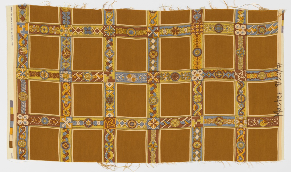 Grid of dark yellow squares with intersecting borders filled with geometric patterning in dark yellow, orange, light blue, and white.