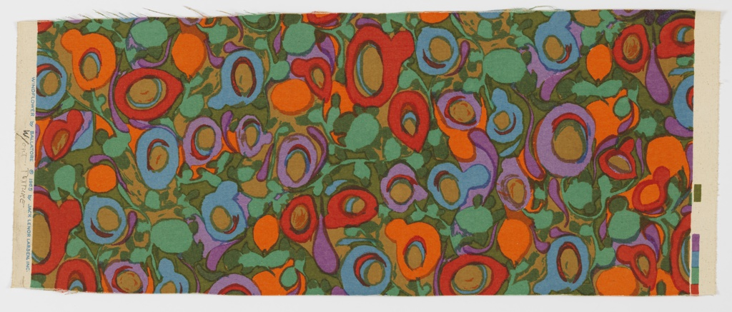 Abstract floral pattern of red, green, orange, purple, dark yellow, and light blue.