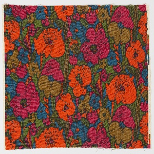 Batik-inspired floral pattern with crackle effects in teal, green, fuchsia, orange, and umber.