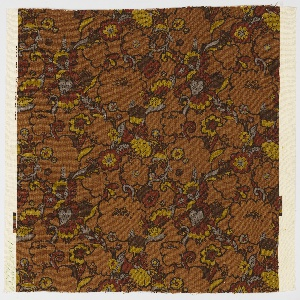 Light brown length patterned with flowers and leaves of rust red, grey and dark yellow with black outlines.