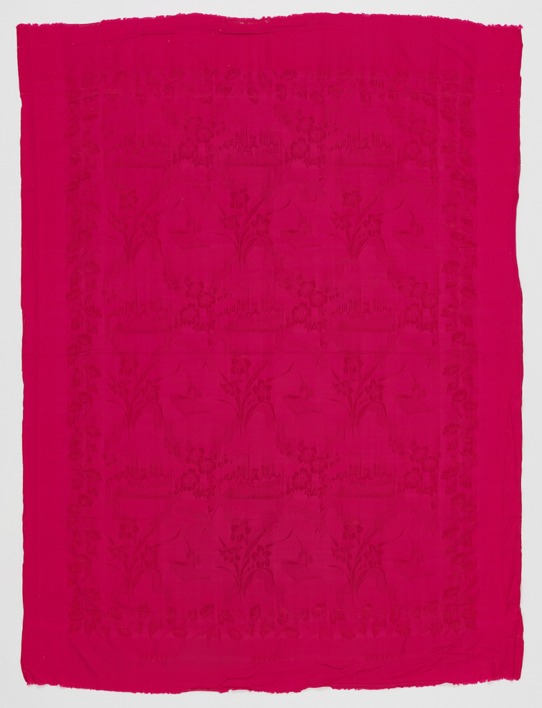 Bright pink synthetic silk quilt cover with monochrome damask design of books and ink well.