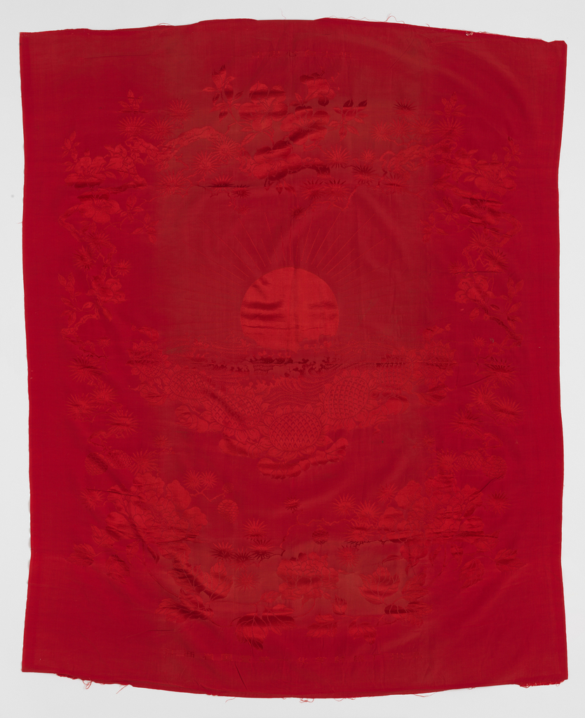 "Red synthetic silk quilt cover with a monochrome damask design of a rising sun surrounded by sunflowers. The inscription at the top of the quilt cover, which translates to ""Loyal Hearts Turn Toward the Sun,"" in Chinese is 一片忠心向太阳 Yipian zhongxin xiang taiyang. The second inscription, at the bottom, is the factory identification, which reads: ""Product of State Owned Number One Synthetics Plant of Jiangxi Province"" (江西省国營第一化學纤维厂出品 Jiangxi sheng guoying diyi huaxue xianwei chang chupin). Surrounded by plum blossoms, symbolizing rejuvenation, and pine trees, connoting longevity."