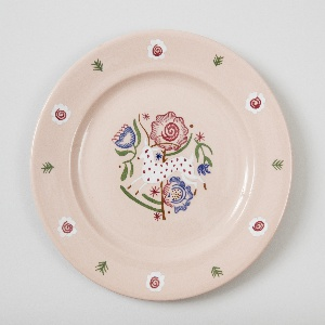 Circular plate with rim decoration of cross-hatchings and abstract flowers and central decoration of leaping doe with oversize flowers