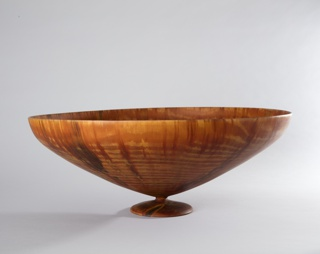 Oval conical bowl on narrow footed circular base