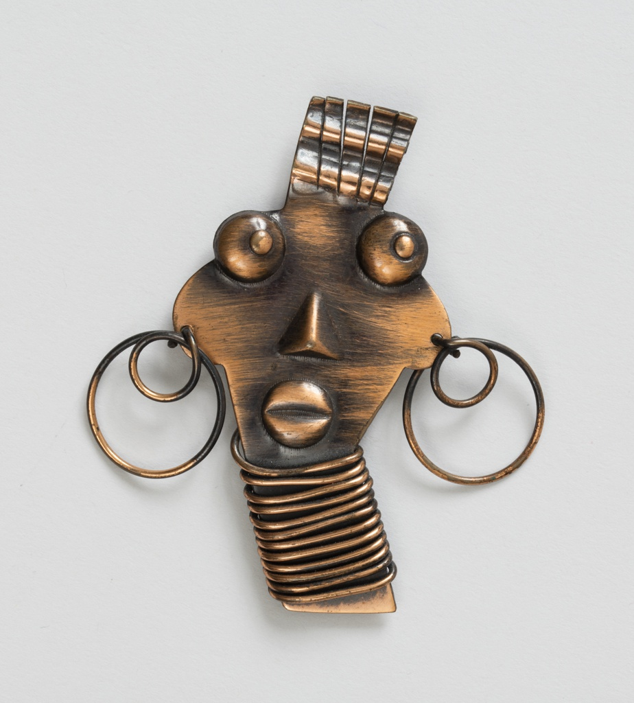 Brooch in the shape of a stylized African woman