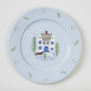 Circular plate with rim decoration of cross-hatchings and leaves and central decoration of house with wooded yard and two dogs