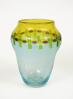 Vase in transparent yellow and light blue glass decorated with round red murrine alternating with transparent green glass rods