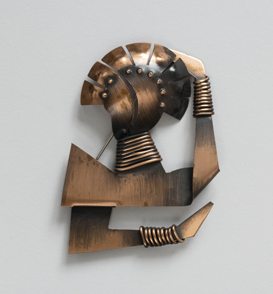 Brooch in the shape of an abstracted African woman
