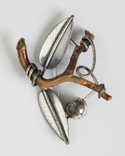 Brooch made with a twig and silver leaves