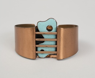 Copper bracelet of a circular sheet with four cross bars with applied biomorphic placque in blue enamel